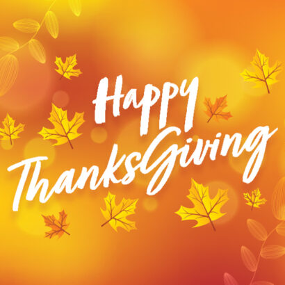 Happy Thanksgiving Font with Autumn Leaves on Orange Blurred Background.